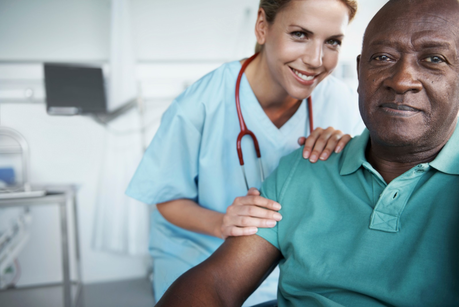Portrait of an African-American man and his nurse standing beside him